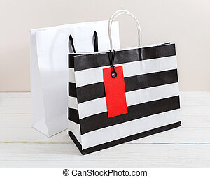 Shopping bag with red tag