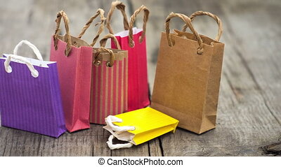 A dolly shot of colorful shopping bags.
