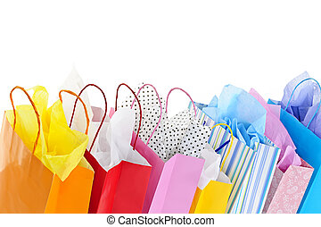 Shopping bags - Many colorful shopping bags on white...