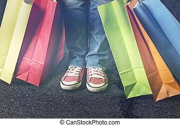 Shopping bags next to female feet.