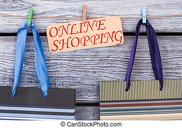 Shopping bags on wooden background.