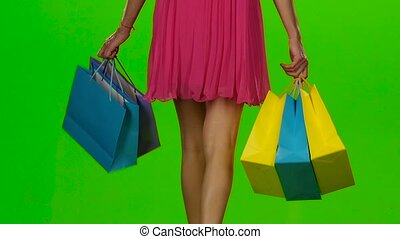 Shopping bags. Sales period. Green screen. Slow motion