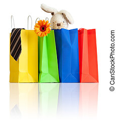 shopping bags with purchases for family on white background with reflection