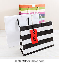 Shopping bags with red sale tag
