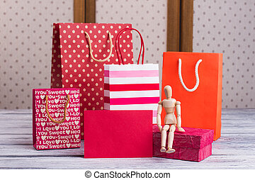 Shopping bags, wooden dummy and blank paper card.