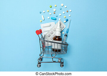 Shopping basket and pills in blisters, syringe and nasal spray. The concept of buying drugs online, delivery of medical devices