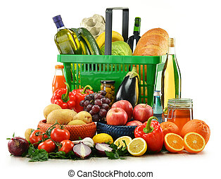 shopping basket with grocery products isolated on white -...