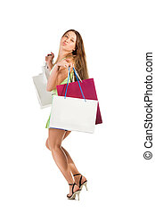 Shopping. Beautiful girl with bag