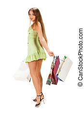 Shopping. Beautiful girl with bag i
