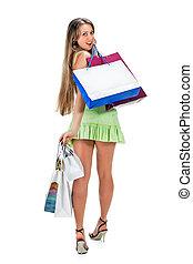 Shopping. Beautiful girl with bag