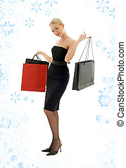 shopping blond in black dress and snowflakes #2