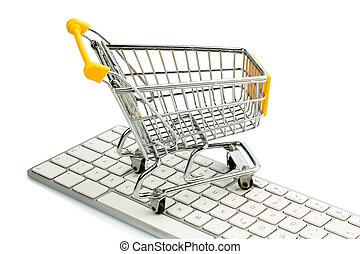 shopping cart and computer keyboard