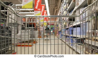 Shopping cart - cart rushes through the supermarket.