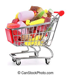 shopping cart full of candies on a white background