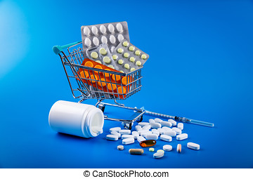 shopping cart full of drug and medicine pills on blue background