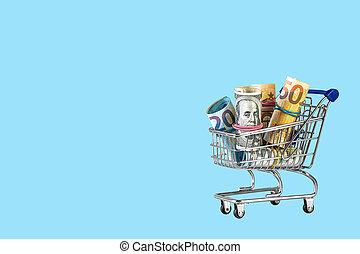 Shopping cart full of money isolated on blue background