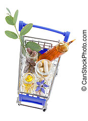 Shopping cart full of pharmaceutical drug ,medicine pills ,plants and food supplement