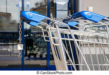 shopping cart in front of a supermarket - in front of a...