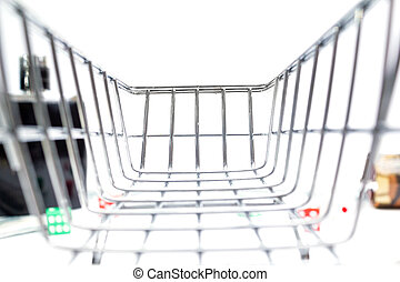 shopping cart inside view in the background in blur dice money cards on a white background isolate