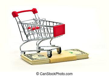 Shopping cart on stack of money isolated on White Background