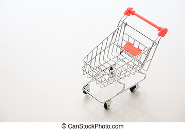 Shopping cart on white background with copy space