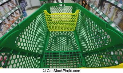 Shopping Cart. - Walking through the shop with green cart....