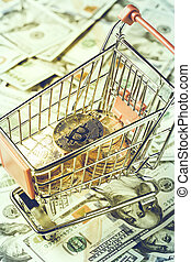 Shopping cart with bitcoins. image toned in vintage dull...