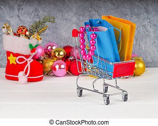 Shopping cart with Christmas gifts and presents, Christmas and New Year sale.