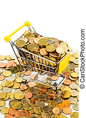 shopping cart with coins - a shopping cart is well stocked...