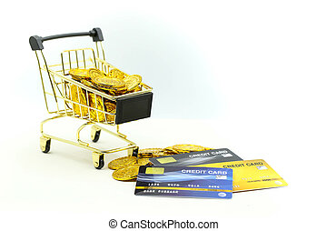 Shopping cart with Credit cards and money stacks of coins, shopping online, business concept.