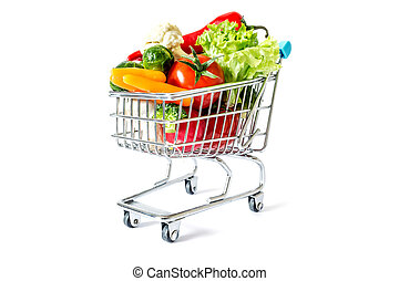 Shopping cart with fresh vegetables close-up isolated on white background