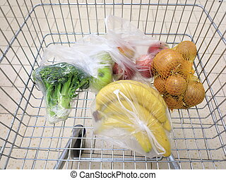 shopping cart with grocery at supermarket