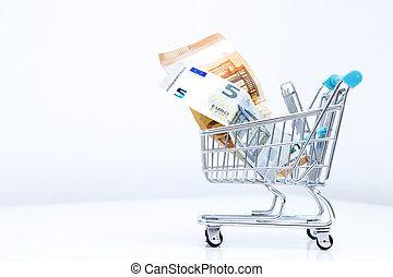 shopping cart with isolated money on white background