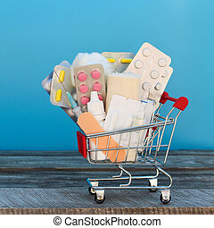 Shopping cart with medication on blue background.