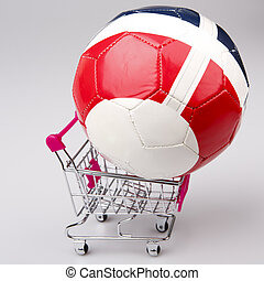 Shopping cart with soccer ball on white background