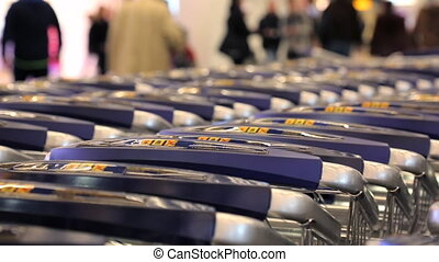Shopping carts nested retail shop people walking background