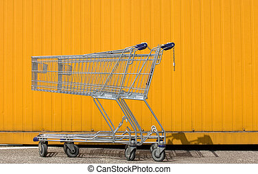 Shopping carts - Two empty shopping carts in front of a...