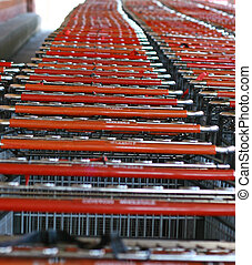 Shopping Carts - Two Rows of red shopping carts at a store