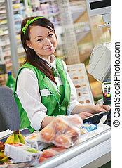 Shopping. Cashdesk worker in supermarket - Portrait of Sales...