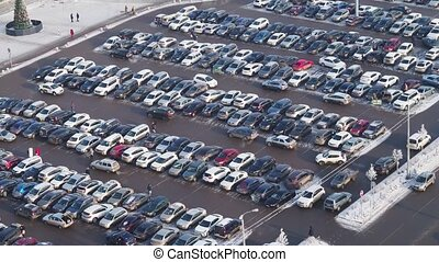 Close view to parking of shopping center full of cars with traffic