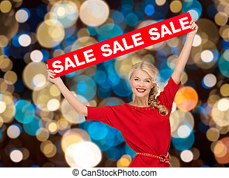 woman in dress with red sale sign
