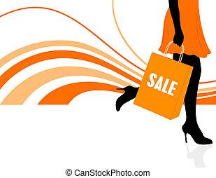 Shopping - Closeup view of a woman holding shopping bag