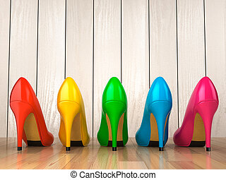 Shopping concept. Choice of colored high heels shoes on...