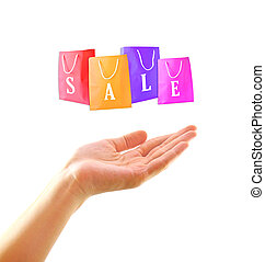 Shopping concept : Woman hand with shopping bag on sale