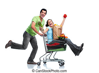 Shopping couple. - Happy couple with a shopping cart. ...