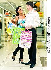 Shopping couple - Portrait of lovely couple standing with...