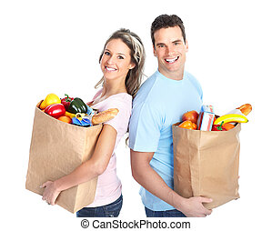 shopping couple with a bag of food - Happy young couple...