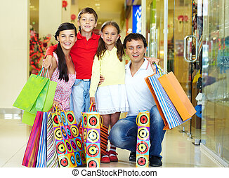 Shopping family - Portrait of a nice family of four with...