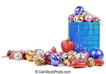 Blue shopping bag with colorful christmas balls , over white