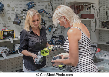 Shopping for diy tools at hardware store.
